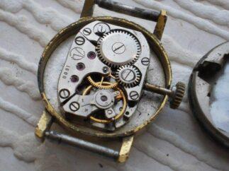 чистка механизма часов